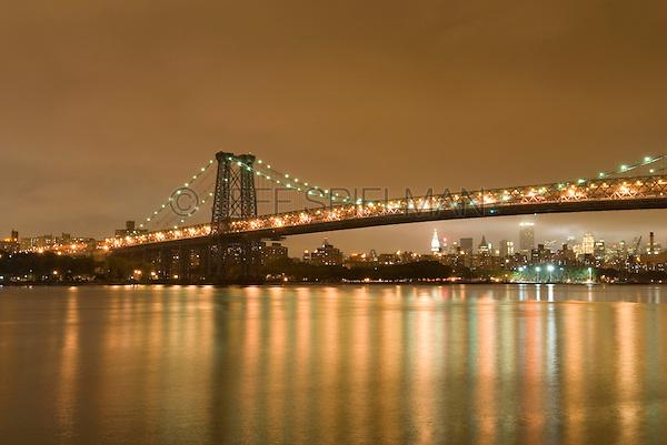Williamsburg Bridge, East River and Manhattan Skyline, Illuminated at Night, New York City, New York State, USA