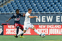 FOXBOROUGH, MA - AUGUST 7: Jose Quintero #59 of Orlando City B clears the ball as Maciel #6 of New England Revolution II pressures during a game between Orlando City B and New England Revolution II at Gillette Stadium on August 7, 2020 in Foxborough, Massachusetts.