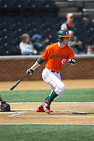 Zack Collins (0) of the Miami Hurricanes follows through on his swing against the Wake Forest Demon Deacons at Wake Forest Baseball Park on March 22, 2015 in Winston-Salem, North Carolina.  The Demon Deacons defeated the Hurricanes 10-4.  (Brian Westerholt/Four Seam Images)