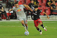WASHINGTON, DC - SEPTEMBER 12: Aaron Long #33 of New York Red Bulls battles for the ball with Kevin Paredes #30 of D.C. United during a game between New York Red Bulls and D.C. United at Audi Field on September 12, 2020 in Washington, DC.