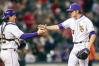 LSU Tigers catcher Kade Scivicque (22) and pitcher Jesse Stallings (37) celebrate winning the NCAA baseball game against the Houston Cougars on March 6, 2015 at Minute Maid Park in Houston, Texas. LSU defeated Houston 4-2. (Andrew Woolley/Four Seam Images)