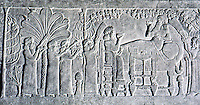 Assyria: King Ashurbanipal banqueting in an arbor with his queen (?). Ninevah, Palace of Ashurbanipal.  Photo '85.
