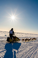 Matt Hall on runs onto the Bering Sea heading toward the finish at Nome on Wednesday March 14th during the 2018 Iditarod Sled Dog Race.  <br /> <br /> Photo by Jeff Schultz/SchultzPhoto.com  (C) 2018  ALL RIGHTS RESERVED
