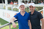 Horseriders Neil Callan (right) and Zac Purton pose for a photograph at UBS pavilion during Hong Kong Open golf tournament at the Fanling golf course on 23 October 2015 in Hong Kong, China. Photo by Moses Ng / Power Sport Images