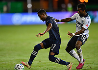 LAKE BUENA VISTA, FL - JULY 26: Gadi Kinda of Sporting KC is pressured by Cristian Dájome of Vancouver Whitecaps FC during a game between Vancouver Whitecaps and Sporting Kansas City at ESPN Wide World of Sports on July 26, 2020 in Lake Buena Vista, Florida.