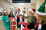 WATERBURY, CT-121917JS08---Nurses and nursing supervisors at Waterbury Hospital, went from floor to floor on Tuesday singing Christmas carols for staff and patients at the hospital. The nursing station on each floor were also presented with a box of chocolates for the staff. <br /> Jim Shannon Republican-American