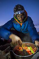 Tomas Contreras on team cooking duty, Valle des los Condores, Chile