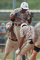 Termarr Johnson (10) celebrates with Kaden Martin (red helmet) and Christian Moore (7) after hitting a home run during the WWBA World Championship at Lee County Player Development Complex on October 11, 2020 in Fort Myers, Florida.  Termarr Johnson, a resident of Atlanta, Georgia who attends Mays High School.  (Mike Janes/Four Seam Images)