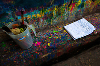 "Clean brushes and a poster sketch are seen placed on a splattered kerb in the sign painting workshop in Cartagena, Colombia, 12 December 2017. Hidden in the dark, narrow alleys of Bazurto market, a group of dozen young men gathered around José Corredor (""Runner""), the master painter, produce every day hundreds of hand-painted posters. Although the vast majority of the production is designed for a cheap visual promotion of popular Champeta music parties, held every weekend around the city, Runner and his apprentices also create other graphic design artworks, based on brush lettering technique. Using simple brushes and bright paints, the artisanal workshop keeps the traditional sign painting art alive."