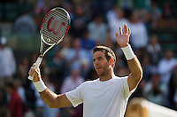 01-07-13, England, London,  AELTC, Wimbledon, Tennis, Wimbledon 2013, Day seven, Juan Martin Del Potro (ARG)<br /> thanks the public after his win over Andreas Seppi (ITA)<br /> <br /> <br /> <br /> <br /> Photo: Henk Koster