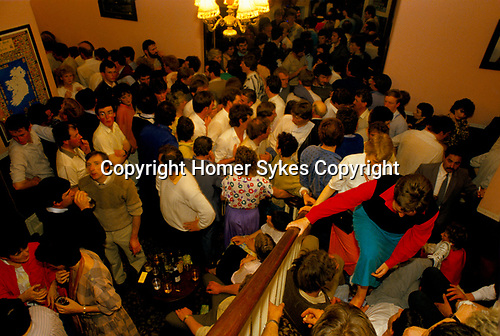 Lisdoonvarna County Clare Eire. Month long annual matchmaking festival. Singles still looking for a partner jam the stair and entrance hall of the Hyrdo Hotel. Its 2am. 1990s.
