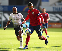 17th October 2020; Liberty Stadium, Swansea, Glamorgan, Wales; English Football League Championship Football, Swansea City versus Huddersfield Town; Christopher Schindler of Huddersfield Town controls the ball under pressure from Andre Ayew of Swansea City