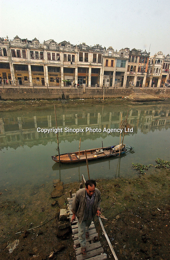 The creek at Chi Kan town in Guangdong Province, China. The houses in the town were built by overseas Chinese returning with architectural ideas from America and Europe. The area is applying for a UNESCO 2005 world Heritage site..