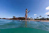 A woman enjoys standup paddling at Ka'anapali Beach, Maui.