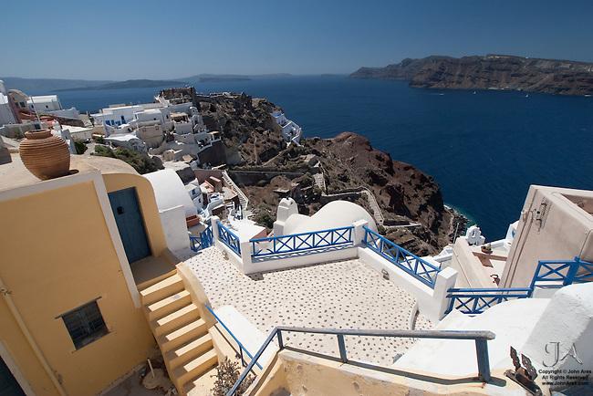 Oia overlooking the Aegean, Ammoudi Harbor and Thirassia