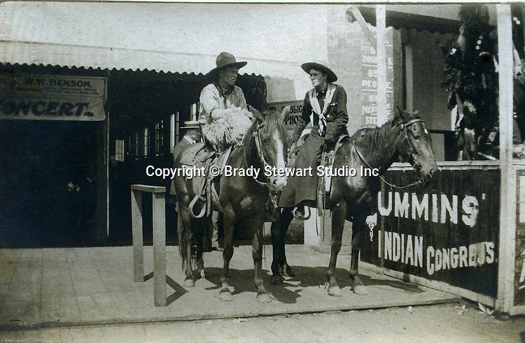 St Louis MO:  A view of two cowboys preparing to participate in one of the daily parades as part of the Cummins Indian Congress show.