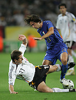 Italian midfielder (21) Andrea Pirlo is fouled by German forward (11) Miroslav Klose.  Italy defeated Germany, 2-0, in overtime in their FIFA World Cup semifinal match at FIFA World Cup Stadium in Dortmund, Germany, July 4, 2006.