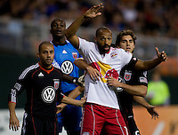 Dejan Jakovic (5) of D.C. United keeps close to Thierry Henry (14) of the New York Red Bulls on a corner kick during the game at RFK Stadium in Washington, DC.  D.C. United lost to the New York Red Bulls, 4-0.