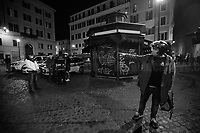 """A citizen complains with members of the press about local police behavior. <br /> <br /> Campo de' Fiori.<br /> <br /> Rome, 23/10/2020. Documenting the """"curfew"""" (coprifuoco) imposed from Friday night in Rome and its surrounding Lazio Region. The local authorities tightened rules and restrictions due to a spike in the Covid-19 / Coronavirus cases. 23 October bulletins sees 19.143 new cases, 91 people died, 182.032 tests made. Today, the President of Lazio Region, Nicola Zingaretti (Leader of the Democratic Party, PD, party member of the Italian Coalition Government), imposed the night curfew, from midnight to 5AM, for 30 days (1.). A new self-certification (autocertificazione, downloadable from here 1.) is needed to leave home which is allowed only for urgent reasons, mainly work and health. Furthermore, the Mayor of Rome, Virginia Raggi, implemented """"no-go zones"""" restrictions from 9PM in some of the areas and squares of the Eternal City famous for the nightlife, including Campo de' Fiori, Via del Pigneto, Piazza Trilussa in Trastevere district and Piazza Madonna de' Monti.<br /> <br /> Footnotes & Links:<br /> 1. http://www.regione.lazio.it/binary/rl_main/tbl_news/ordinanza_regione_lazio_intesa_Ministro_salute__mod_accettate_rev1__ore_24_1_signed.pdf<br /> <br /> March 2020, Coronavirus lockdown in Rome:<br /> - 12.03.2020 - Rome's Lockdown for the Outbreak of the Coronavirus In Italy - SARS-CoV-2 - COVID-19: https://lucaneve.photoshelter.com/gallery/12-03-2020-Romes-Lockdown-for-the-Outbreak-of-the-Coronavirus-In-Italy-SARS-CoV-2-COVID-19/G0000jGtenBegsts/<br /> - 07-23.03.2020 - Villaggio Olimpico Ai Tempi del COVID-19 - Rome's Olympic Village Under Lockdown: https://lucaneve.photoshelter.com/gallery/07-23-03-2020-Villaggio-Olimpico-Ai-Tempi-del-COVID-19-Romes-Olympic-Village-Under-Lockdown/G0000D2L9l0ibXZI/"""