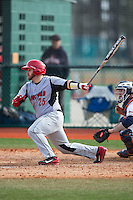 Billy Walker (25) of the Hartford Hawks follows through on his swing against the Virginia Cavaliers at The Ripken Experience on February 27, 2015 in Myrtle Beach, South Carolina.  The Cavaliers defeated the Hawks 5-1.  (Brian Westerholt/Four Seam Images)