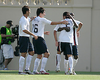 Ante Razov, Sacha Kljestan, Benny Feilhaber, and DaMarcus Beasley celebrate Feilhaber's goal. The USA defeated China, 4-1, in an international friendly at Spartan Stadium, San Jose, CA on June 2, 2007.
