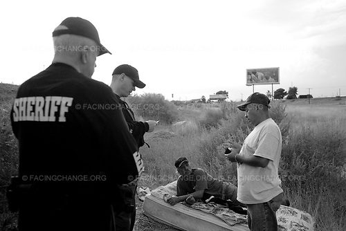 Phoenix, Arizona ,USA<br /> June 2010<br /> <br /> Deputy Brent Kowmorowski of the Maricopa County Sheriff office stops to talk to two men individuals who were seen resting on the side of the road Thursday July 29, 2010 in Avondale.The deputy after talking to the subjects and checked their identification and decided there was no wrong doing allowed the men to continue on with their day.  Phoenix,  .Pro SB 1070 supporters argue with a anti SB 1070 members at a rally on the Arizona State Capitol grounds during a public rally held in favor of Arizona's controversial Senate Bill, 1070 aimed at illegal immigration, Phoenix, Arizona, USA, on 31 July 2010. The state's controversial law went into effect at 12 01 am on 29 July but with a limited effect as Judge Susan Bolton put a injunction on the most controversial parts that many people say was unconstitutional and based on racial profiling.