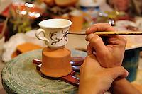 Artigiani a San Lorenzo , quartiere storico di Roma.<br /> MADRAS, produzione di ceramiche artistiche. Sabrina Scuro nel suo laboratorio mentre prepara oggetti ceramici.<br /> Craftsmen in San Lorenzo, historic district of Rome.<br /> MADRAS, production of ceramic art. Sabrina Scuro  in her laboratory while preparing ceramic objects.