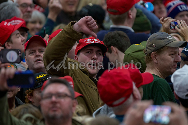 A supporters gives the media a thumbs down as United States President Donald J. Trump speaks during a Make America Great Again campaign rally at Atlantic Aviation in Moon Township, Pennsylvania on March 10th, 2018. Photo Credit: Alex Edelman/CNP/AdMedia