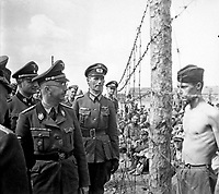 Himmler besichtigt die Gefangenenlager in Russland.  Heinrich Himmler inspects a prisoner-of-war camp in Russia.  Ca. 1940-41.  Heinrich Hoffman Collection.  (Foreign Record Seized)<br /> Exact Date Shot Unknonw<br /> NARA FILE #:  242-HB-47721-306<br /> WAR & CONFLICT BOOK #:  1275