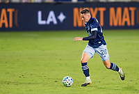 CARSON, CA - OCTOBER 18: Jake Nerwinski #28 of the Vancouver Whitecaps moves with the ball looking for an open man during a game between Vancouver Whitecaps and Los Angeles Galaxy at Dignity Heath Sports Park on October 18, 2020 in Carson, California.