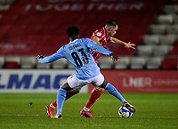 Lincoln City's Theo Archibald vies for possession with Manchester City U21's Oluwatimilehin Sobowale<br /> <br /> Photographer Andrew Vaughan/CameraSport<br /> <br /> EFL Papa John's Trophy - Northern Section - Group E - Lincoln City v Manchester City U21 - Tuesday 17th November 2020 - LNER Stadium - Lincoln<br />  <br /> World Copyright © 2020 CameraSport. All rights reserved. 43 Linden Ave. Countesthorpe. Leicester. England. LE8 5PG - Tel: +44 (0) 116 277 4147 - admin@camerasport.com - www.camerasport.com