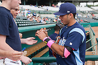 Corpus Christi Hooks shortstop Carlos Correa (1) signs autographs before the Texas League baseball game against the San Antonio Missions on May 10, 2015 at Nelson Wolff Stadium in San Antonio, Texas. The Missions defeated the Hooks 6-5. (Andrew Woolley/Four Seam Images)