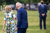 US President Joe Biden gives First Lady Jill Biden a dandelion as they walk to board Marine One on the Ellipse of the White House in Washington, DC, USA, 29 April 2021. President Biden is traveling to Georgia today for an event to mark his 100th day in office and to pay a visit to former US President Jimmy Carter.<br /> CAP/MPI/RS<br /> ©RS/MPI/Capital Pictures