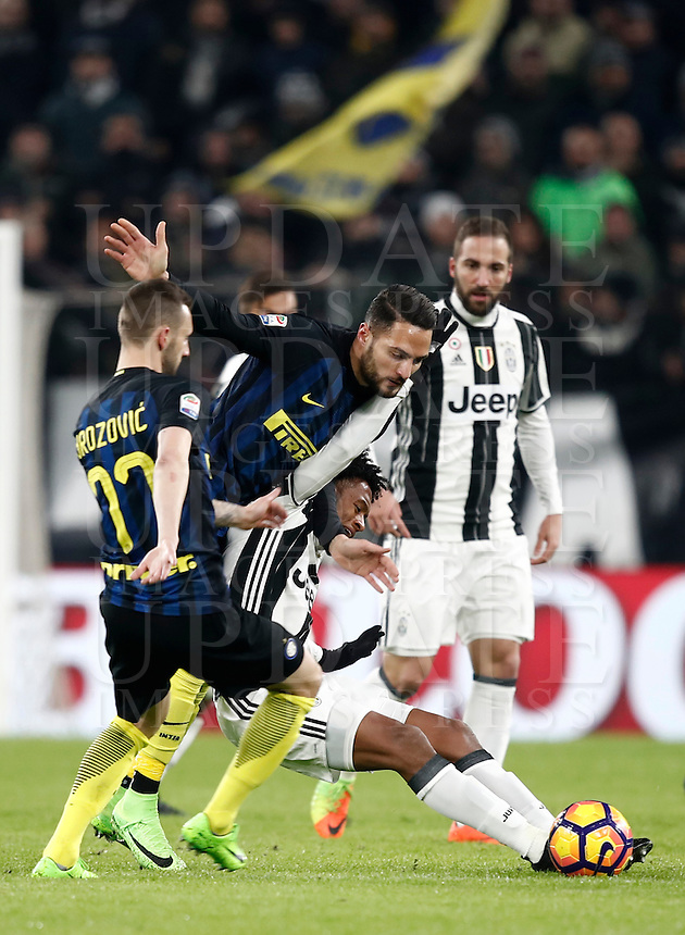 Calcio, Serie A: Torino, Juventus Stadium, 5 febbraio 2017.<br /> From left: Inter Milan's Marcelo Brozovic and Danilo D'Ambrosio in action with Juventu's Juan Cuadrado during the Italian Serie A football match between Juventus and Inter Milan at Turin's Juventus Stadium, on February 5, 2017.<br /> UPDATE IMAGES PRESS/Isabella Bonotto