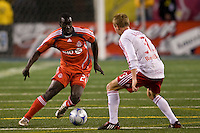 Toronto FC forward Johann Smith (28) and New York Red Bulls defender Chris Leitch (33). Toronto FC defeated the New York Red Bulls 3-1 during a Major League Soccer match at Giants Stadium in East Rutherford, NJ, on October 04, 2008. Photo by Howard C. Smith/isiphotos.com