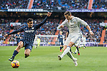 Cristiano Ronaldo (r) of Real Madrid fights for the ball with Roberto Rosales of Malaga CF during their La Liga 2016-17 match between Real Madrid and Malaga CF at the Estadio Santiago Bernabéu on 21 January 2017 in Madrid, Spain. Photo by Diego Gonzalez Souto / Power Sport Images