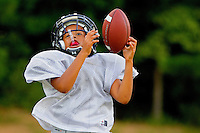 Players learn the game of football on a Pop Warner's Lake Norman Giants football team. .Photography by: Patrick Schneider Photo.com