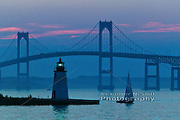 Blue dusk settles over the Newport Pell bridge, Goat Island green light and a single sail boat