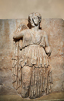Roman Sebasteion relief sculpture of Ethnos with belted peplos, Aphrodisias Museum, Aphrodisias, Turkey.  Against an art background.<br /> <br /> The matronly figure wears a belted classical dress (peplos) and held her long cloak up behind. The square hole above her shoulder with a corresponding hole in the back, was for lifting the finished relief into the ancient building by crane.
