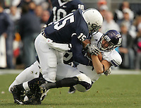 State College, PA - 11/06/2010:  Penn State LB Bani Gbadyu makes a tackle.  Despite trailing 21-0 in the first quarter, Penn State defeated Northwestern by a score of 35-21 at Beaver Stadium to give head coach Joe Paterno his 400th career victory...Photo:  Joe Rokita / JoeRokita.com..Photo ©2010 Joe Rokita Photography