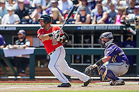 Texas Tech Red Raiders first baseman Eric Gutierrez (12) follows through on his swing against the TCU Horned Frogs in Game 3 of the NCAA College World Series on June 19, 2016 at TD Ameritrade Park in Omaha, Nebraska. TCU defeated Texas Tech 5-3. (Andrew Woolley/Four Seam Images)