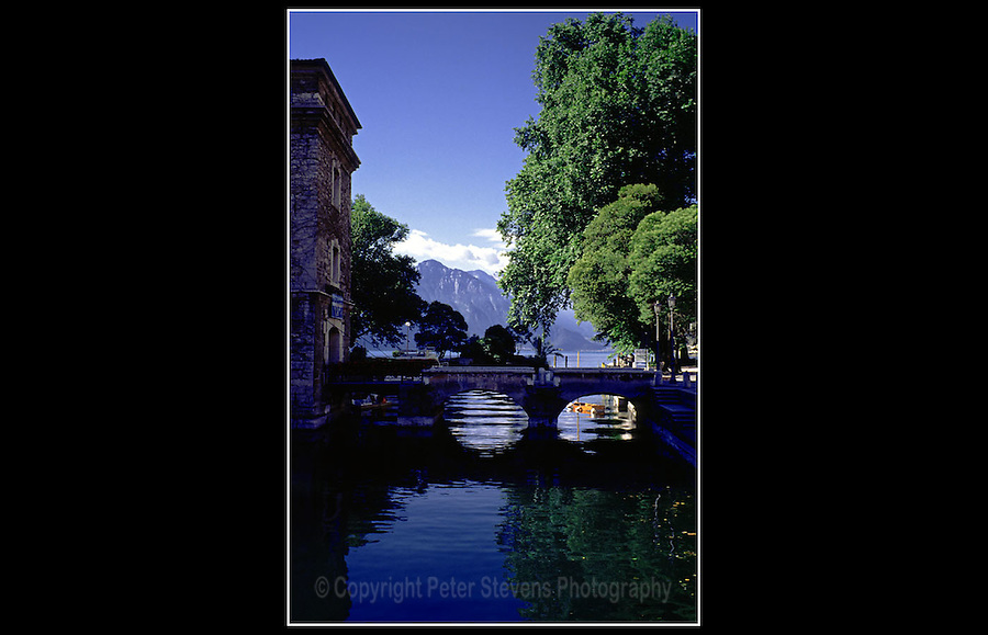 Riva del Garda, Italy - June 1997 - <br /> <br /> Also known as Riva, is a town in the Italian province of Trento, located at the north-western corner of Lake Garda, at the southern edge of the Italian Alps, near to the Dolomites.
