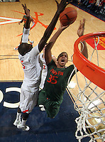 CHARLOTTESVILLE, VA- JANUARY 7: Kenny Kadji #35 of the Miami Hurricanes shoots the ball next to Assane Sene #5 of the Virginia Cavaliers during the game on January 7, 2012 at the John Paul Jones Arena in Charlottesville, Virginia. Virginia defeated Miami 52-51. (Photo by Andrew Shurtleff/Getty Images) *** Local Caption *** Assane Sene;Kenny Kadji