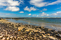"""""""Rivière des Galets"""" pebble beach, filled with smooth, black stones and golden sand, on the Indian Ocean in Mauritius Island, Africa"""