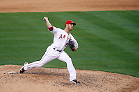 Michael Kohn #58 of the Los Angeles Angels pitches against the New York Yankees at Angel Stadium on June 15, 2013 in Anaheim, California. (Larry Goren/Four Seam Images)