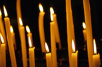 Candles burning in the Auch Cathedral, Auch, France.