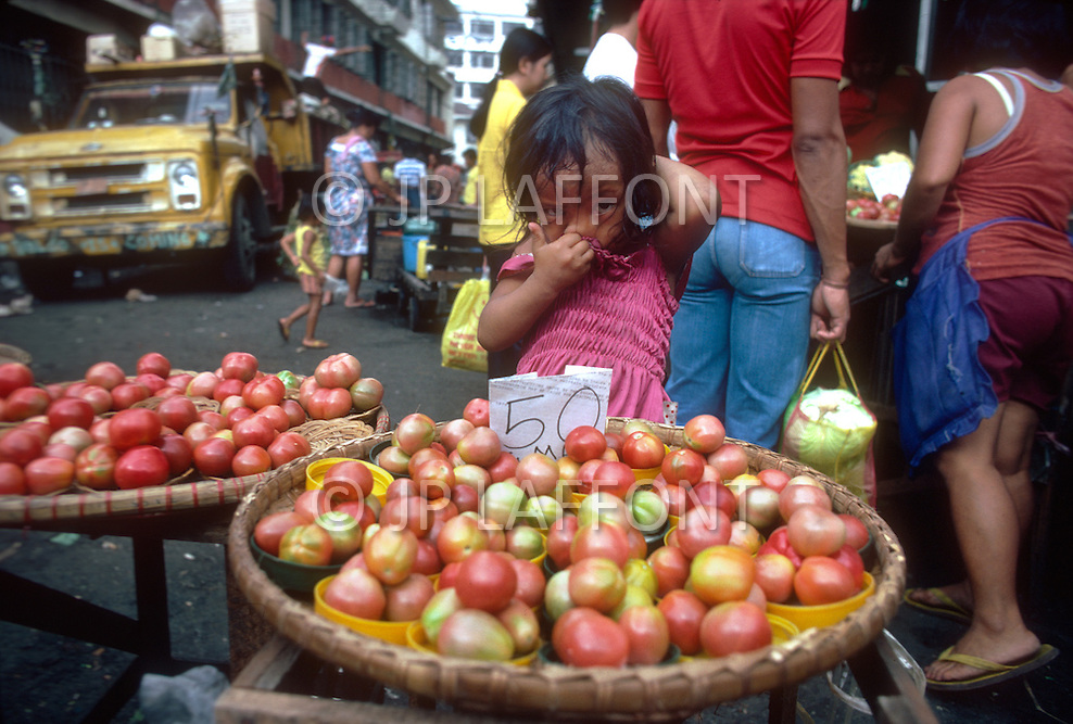 Child street vendor in Manilla, Philippines - Child labor as seen around the world between 1979 and 1980 - Photographer Jean Pierre Laffont, touched by the suffering of child workers, chronicled their plight in 12 countries over the course of one year.  Laffont was awarded The World Press Award and Madeline Ross Award among many others for his work.