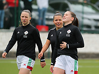 Estee Cattoor (11) of OHL, Luna Vanzeir (10) of OHL and Marie Detruyer (17) of OHL sharing a private joke during the warm up before a female soccer game between Oud Heverlee Leuven and AA Gent Ladies on the 9 th matchday of play off 1 in the 2020 - 2021 season of Belgian Womens Super League , saturday 22 nd of May 2021  in Heverlee , Belgium . PHOTO SPORTPIX.BE | SPP | SEVIL OKTEM