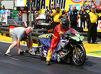 Mar 13, 2015; Gainesville, FL, USA; NHRA pro stock motorcycle rider Shawn Gann is lined up by father Blake Gann during qualifying for the Gatornationals at Auto Plus Raceway at Gainesville. Mandatory Credit: Mark J. Rebilas-