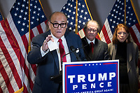 Former Mayor Rudy Giuliani (Republican of New York, New York) holds up an example of what he calls voter fraud as he conducts a press conference at Republican National Committee headquarters in Washington, DC on Thursday, November 19, 2020.  He is accompanied by Trump Campaign Senior Legal Advisor Jenna Ellis and other attorneys.<br /> Credit: Rod Lamkey / CNP /MediaPunch